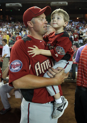 PHOENIX, AZ - JULY 11:  American League All-Star Michael Cuddyer #5 of the Minnesota Twins looks on with his son Casey during the 2011 State Farm Home Run Derby at Chase Field on July 11, 2011 in Phoenix, Arizona.  (Photo by Jeff Gross/Getty Images)