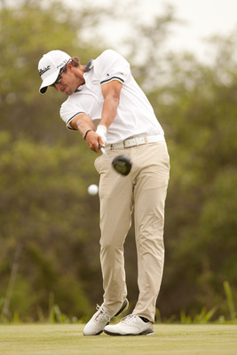 SAN ANTONIO, TX - APRIL 17: Adam Scott of Australia follows through on a tee shot during the final round of the Valero Texas Open at the AT&T Oaks Course at TPC San Antonio on April 17, 2011 in San Antonio, Texas. (Photo by Darren Carroll/Getty Images)