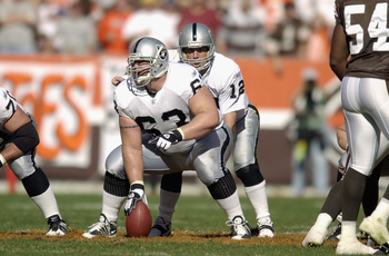 CLEVELAND, OH - OCTOBER 12:  Center Barret Robbins #63 of the Oakland Raiders gets set to snap the ball to quarterback Rich Gannon #12 during the game against the Cleveland Browns on October 12, 2003 at Cleveland Browns Stadium in Cleveland, Ohio.  The Br