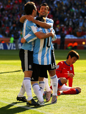 JOHANNESBURG, SOUTH AFRICA - JUNE 17:  Lionel Messi and Sergio Aguero of Argentina celebrate the second goal by Gonzalo Higuain (L) of Argentina during the 2010 FIFA World Cup South Africa Group B match between Argentina and South Korea at Soccer City Sta