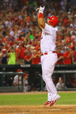 ST. LOUIS, MO - JULY 9: Albert Pujols #5 of the St. Louis Cardinals is celebrates after hitting a two-run home run against the Arizona Diamondbacks at Busch Stadium on July 9, 2011 in St. Louis, Missouri.  The Cardinals beat the Diamondbacks 7-6.  (Photo