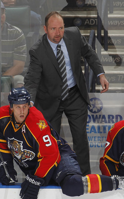 SUNRISE, FL - FEBRUARY 8: Head coach Peter DeBoer of the Florida Panthers stands on the bench late in the third period against the St Louis Blues on February 8, 2011 at the BankAtlantic Center in Sunrise, Florida. The Blues defeated the Panthers 2-1. (Pho