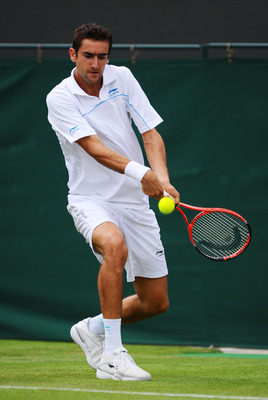 LONDON, ENGLAND - JUNE 20:  Marin Cilic of Croatia returns a shot during his first round match against Ivan Ljubicic of Croatia on Day One of the Wimbledon Lawn Tennis Championships at the All England Lawn Tennis and Croquet Club on June 20, 2011 in Londo