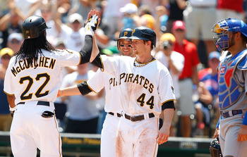 PITTSBURGH - JULY 10:  Andrew McCutchen #22 of the Pittsburgh Pirates is congratulated by teammates Alex Presley #44 and Neil Walker #18 after hitting a three run home run against the Chicago Cubs in the third inning during the game on July 10, 2011 at PN