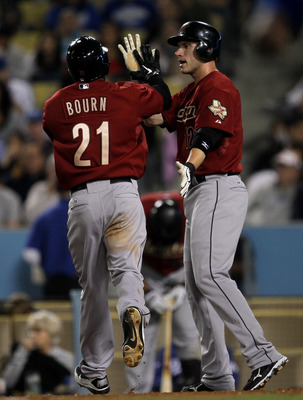 LOS ANGELES, CA - JUNE 18:  Clint Barmes #12 and Michael Bourn #21 of the Houston Astros celebrate as they both score on a single by Jeff Keppinger int eh fifth inning against the Los Angeles Dodgers on June 18, 2011 at Dodger Stadium in Los Angeles, Cali