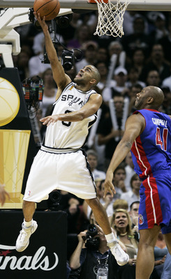 SAN ANTONIO - JUNE 23: Tony Parker #9 of the San Antonio Spurs gets a basket past the defense of Elden Campbell #41 of the Detroit Pistons in in the first half of Game seven of the 2005 NBA Finals at SBC Center on June 23, 2005 in San Antonio, Texas.  NOT