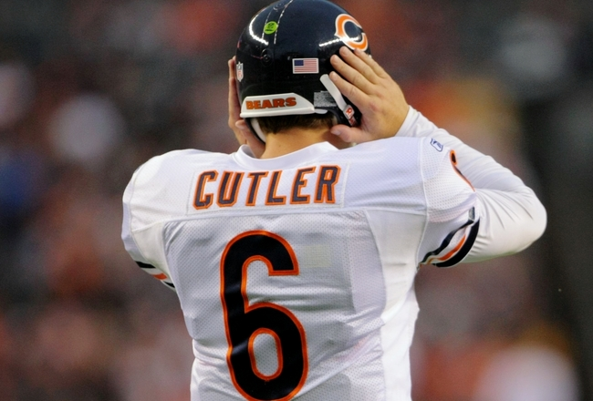 DENVER - AUGUST 30: Quarterback Jay Cutler #6 of the Chicago Bears has trouble hearing the play in his headset during the preseason game against the Denver Broncos at INVESCO Field at Mile High on August 30, 2009 in Denver, Colorado. (Photo by Doug Pensin