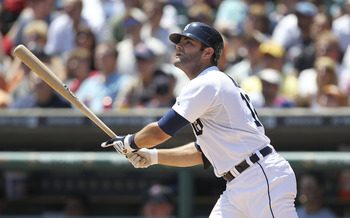 DETROIT - JUNE 30: Alex Avila #13 of the Detroit Tigers hits a sacrfice fly in the third inning scoring teammate Victor Martinez #41 during the game against the New York Mets at Comerica Park on June 30, 2011 in Detroit, Michigan.  (Photo by Leon Halip/Ge