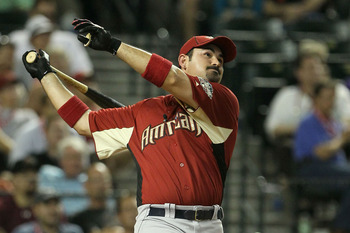PHOENIX, AZ - JULY 11:  American League All-Star Adrian Gonzalez #28 of the Boston Red Sox participates in the final round of the 2011 State Farm Home Run Derby at Chase Field on July 11, 2011 in Phoenix, Arizona.  (Photo by Jeff Gross/Getty Images)