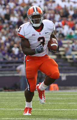 SEATTLE - SEPTEMBER 11:  Running back Delone Carter #3 of the Syracuse Orange rushes against the Washington Huskies on September 11, 2010 at Husky Stadium in Seattle, Washington. (Photo by Otto Greule Jr/Getty Images)