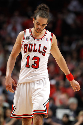CHICAGO, IL - MAY 18:  Joakim Noah #13 of the Chicago Bulls walks up court with hi shead down against the Miami Heat in Game Two of the Eastern Conference Finals during the 2011 NBA Playoffs on May 18, 2011 at the United Center in Chicago, Illinois. The H