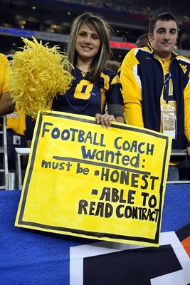 GLENDALE, AZ - JANUARY 02:  West Virginia Mountaineers fans hold up a sign in the second half as the Mountaineers take on the Oklahoma Sooners at the Tostito's Fiesta Bowl at University of Phoenix Stadium January 2, 2008 in Glendale, Arizona.  (Photo by S