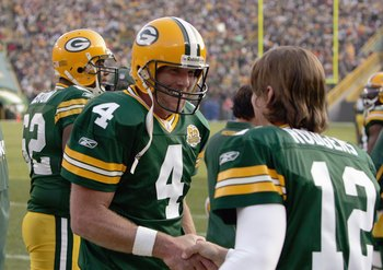 GREEN BAY, WI - NOVEMBER 11: Brett Favre #4 of the Green Bay Packers talks with  Aaron Rodgers #12 during the game against the Minnesota Vikings give chase on November 11, 2007 at Lambeau Field in Green Bay, Wisconsin. (Photo by Jonathan Daniel/Getty Imag