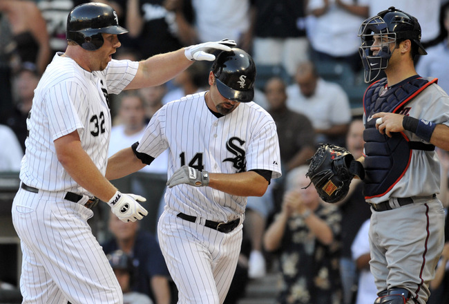 CHICAGO, IL - JULY 08: Adam Dunn # 32 of the Chicago White Sox  is greeted by Paul Konerko #14 after hitting a 2-run homer against the Minnesota Twins in the first inning on July 8, 2011 at U.S. Cellular Field in Chicago, Illinois.  (Photo by David Banks/