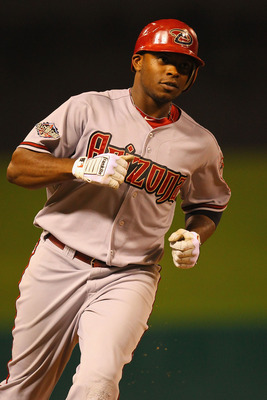 ST. LOUIS, MO - JULY 7: Justin Upton #10 of the Arizona Diamondbacks rounds the bases after hitting a two-run home run against the St. Louis Cardinals at Busch Stadium on July 7, 2011 in St. Louis, Missouri.  (Photo by Dilip Vishwanat/Getty Images)