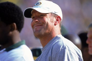 26 Aug 2000: Brett Favre  of the Green Bay Packers smiles from the sidelines as he sits out the game during the Pre-Season game against the Cleveland Browns at Lambeau Field in Green Bay, Wisconsin. The Packers defeated the Browns 34-33.Mandatory Credit:
