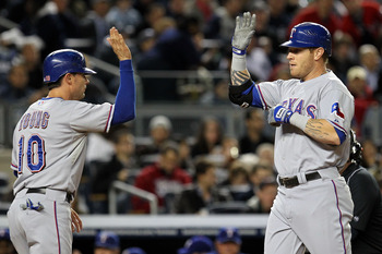 NEW YORK - OCTOBER 18: Josh Hamilton #32 of the Texas Rangers celebrates with Michael Young #10 after hitting a two run homerun in the first inning against the New York Yankeesin Game Three of the ALCS during the 2010 MLB Playoffs at Yankee Stadium on Oct