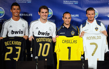 LOS ANGELES, CA - JULY 12:  Real Madrid players  Cristiano Ronaldo, goalkeeper Iker Casillas and Los Angeles Galaxy players Landon Donovan and David Beckham pose after a news conference to announce the Herbalife World Football Challange 2011 friendly socc