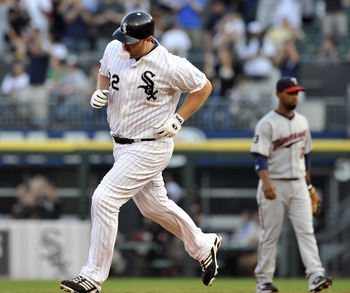 CHICAGO, IL - JULY 08: Adam Dunn # 32 of the Chicago White Sox hits a 2-run homer against the Minnesota Twins in the first inning on July 8, 2011 at U.S. Cellular Field in Chicago, Illinois.  (Photo by David Banks/Getty Images)
