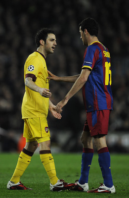 BARCELONA, SPAIN - MARCH 08:  Cesc Fabregas of Arsenal (L) argues with Sergio Busquets of FC Barcelona during the UEFA Champions League round of 16 second leg match between Barcelona and Arsenal at the Camp Nou stadium on March 8, 2011 in Barcelona, Spain