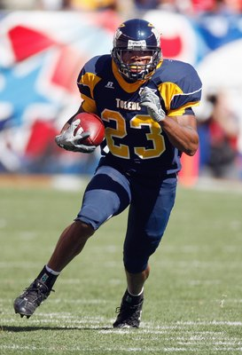 CLEVELAND - SEPTEMBER 19: Morgan Williams #23 of the Toledo Rockets carries the ball during the game against the Ohio State Buckeyes  at Cleveland Browns Stadium on September 19, 2009 in Cleveland, Ohio. The Ohio State Buckeyes shutout the Toledo Rockets