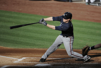 SAN DIEGO, CA - JUNE 25: Nate McLouth #13 of the Atlanta Braves hits an RBI single during the second inning of a baseball game against the San Diego Padres at Petco Park on June 25, 2011 in San Diego, California.  (Photo by Denis Poroy/Getty Images)