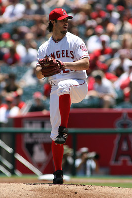 ANAHEIM, CA - JULY 10:  Dan Haren #24 of the Los Angeles Angels of Anaheim pitches against the Seattle Mariners in the first inning of the game at Angel Stadium of Anaheim on July 10, 2011 in Anaheim, California  (Photo by Jeff Golden/Getty Images)