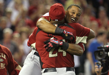 PHOENIX, AZ - JULY 11:  American League All-Star Robinson Cano #24 of the New York Yankees hugs his father Jose after winning the 2011 State Farm Home Run Derby at Chase Field on July 11, 2011 in Phoenix, Arizona. Cano won the 2011 State Farm Home Run Der