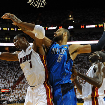 MIAMI, FL - JUNE 12:  Chris Bosh #1 of the Miami Heat and Tyson Chandler #6 of the Dallas Mavericks fight for control of the ball in the first half of Game Six of the 2011 NBA Finals at American Airlines Arena on June 12, 2011 in Miami, Florida. NOTE TO U