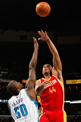 NEW ORLEANS, LA - JANUARY 02:  Chuck Hayes #44 of the Houston Rockets makes a shot over Emeka Okafor #50 of the New Orleans Hornets at the New Orleans Arena on January 2, 2010 in New Orleans, Louisiana.   The Hornets defeated the rockets 99-95.  NOTE TO U