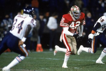 SAN FRANCISCO - DECEMBER 14:  Safety Ronnie Lott #42 of the San Francisco 49ers runs with the ball against the Chicago Bears during a game at Candlestick Park on December 14, 1987 in San Francisco, California.  The 49ers won 41-0.  (Photo by George Rose/G