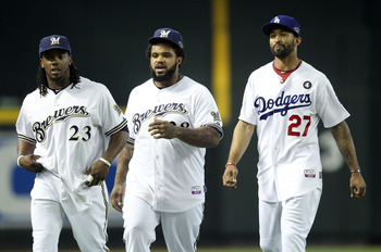 PHOENIX, AZ - JULY 12:  National League All-Star Rickie Weeks #23 of the Milwaukee Brewers, National League All-Star Prince Fielder #28 of the Milwaukee Brewers and National League All-Star Matt Kemp #27 of the Los Angeles Dodgers talk in the outfield dur