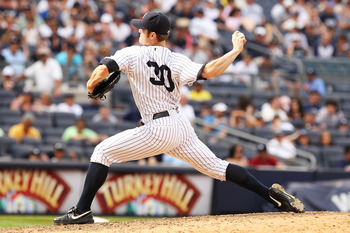 NEW YORK, NY - JUNE 26:  David Robertson #30 of the New York Yankees in action against the Colorado Rockies during their game on June 26, 2011 at Yankee Stadium in the Bronx borough of New York City.  (Photo by Al Bello/Getty Images)