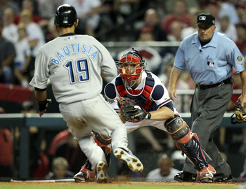 PHOENIX, AZ - JULY 12:  National League All-Star Brian McCann #16 of the Atlanta Braves looks to tag out American League All-Star Jose Bautista #19 of the Toronto Blue Jays is tagged out on a throw by National League All-Star Hunter Pence #9 of the Housto