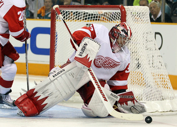 SAN JOSE, CA - MAY 12:  Jimmy Howard #35 of the Detroit Red Wings makes a save against the San Jose Sharks in Game Seven of the Western Conference Semifinals during the 2011 NHL Stanley Cup Playoffs at HP Pavilion on May 12, 2011 in San Jose, California.