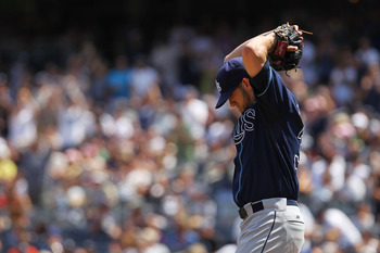 NEW YORK, NY - JULY 10:  James Shields #33 of the Tampa Bay Rays reacts after his error lead to a New York Yankees scored run  at Yankee Stadium on July 10, 2011 in the Bronx borough of New York City.  (Photo by Nick Laham/Getty Images)