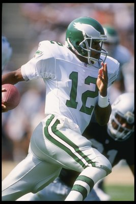 24 Sep 1995:  Quarterback Randall Cunningham #12 of the Philadelphia Eagles scrambles against the Oakland Raiders during a game played at the Oakland Coliseum in Oakland, California.  The Raiders won the game, 48-17. Mandatory Credit: Al Bello/Allsport