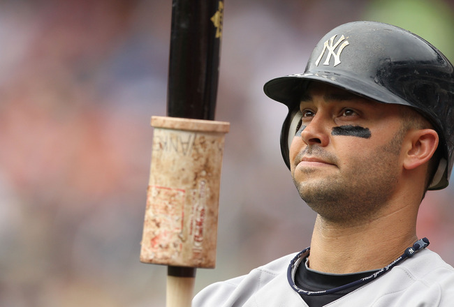 NEW YORK, NY - JULY 03:  Nick Swisher #33 of the New York Yankees looks on against the New York Mets during their game on July 3, 2011 at Citi Field in the Flushing neighborhood of the Queens borough of New York City.  (Photo by Al Bello/Getty Images)