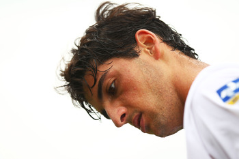 LONDON, ENGLAND - JUNE 20: Thomaz Bellucci of Brazil takes a break during his first round match against Rainer Schuttler of Germany on Day One of the Wimbledon Lawn Tennis Championships at the All England Lawn Tennis and Croquet Club on June 20, 2011 in L