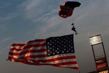 FRISCO, TX - JULY 02:  Former U.S. Army Special Forces soldier, Golden Knight, and double amputee member Dana Bowman jumps into Pizza Hut Park with the American flag on July 2, 2011 in Frisco, Texas.  (Photo by Tom Pennington/Getty Images)