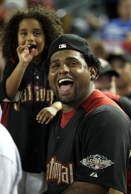 PHOENIX, AZ - JULY 11:  National League All-Star Pablo Sandoval #48 of the San Francisco Giants looks on with his daughter Yoleadny during the 2011 State Farm Home Run Derby at Chase Field on July 11, 2011 in Phoenix, Arizona.  (Photo by Christian Peterse