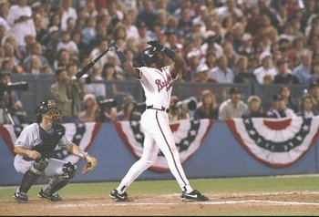 6 Oct 1995: First baseman Fred McGriff of the Atlanta Braves is at bat as catcher Joe Girardi of the Colorado Rockies squats behind him during a game at Fulton County Stadium in Atlanta, Georgia. The Rockies won the game 7-5.