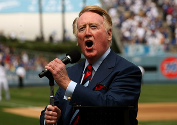 LOS ANGELES - APRIL 13:  Dodgers broadcaster Vin Scully gives the call of 'It's time for Dodger baseball!' during pregame ceremonies for the Los Angeles Dodgers home opener against the San Francisco Giants on April 13, 2009 at Dodger Stadiium in Los Angel