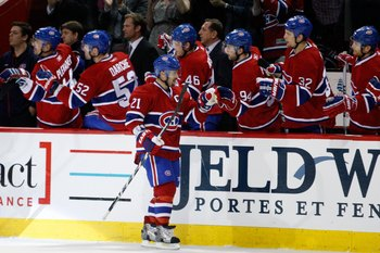 MONTREAL, CANADA - JANUARY 8:  Brian Gionta #21 of the Montreal Canadiens celebrates a goal with team mates during the NHL game against the Boston Bruins at the Bell Centre on January 8, 2011 in Montreal, Quebec, Canada.  The Canadiens defeated the Bruins