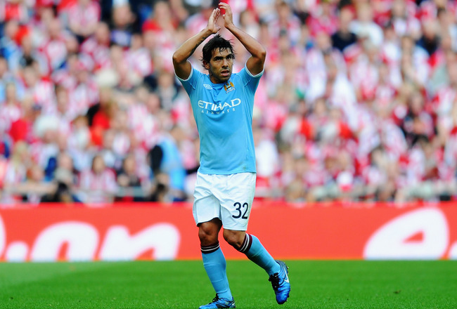 LONDON, ENGLAND - MAY 14: Carlos Tevez of Manchester City applauds his sides fans as he is substituted during the FA Cup sponsored by E.ON Final match between Manchester City and Stoke City at Wembley Stadium on May 14, 2011 in London, England. (Photo by