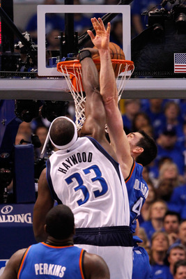 DALLAS, TX - MAY 25:  Brendan Haywood #33 of the Dallas Mavericks dunks the ball over Nick Collison #4 of the Oklahoma City Thunder in the second quarter in Game Five of the Western Conference Finals during the 2011 NBA Playoffs at American Airlines Cente