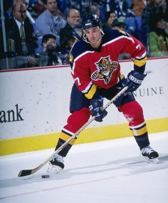11 Nov 1996:  Defenseman Rhett Warrener of the Florida Panthers moves the puck during a game against the Buffalo Sabres at the Marine Midland Arena in Buffalo, New York.  The Sabres won the game, 3-2. Mandatory Credit: Rick Stewart  /Allsport