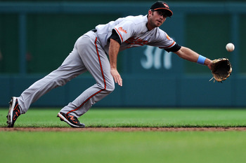 WASHINGTON, DC - JUNE 19: Shortstop J.J. Hardy #2 of the Baltimore Orioles tries to pull in a hit against the Washington Nationals in the third inning at Nationals Park on June 19, 2011 in Washington, DC. (Photo by Patrick Smith/Getty Images)