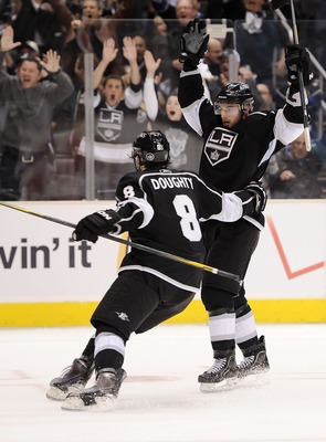 LOS ANGELES, CA - APRIL 21:  Brad Richardson #15 and Drew Doughty #8 of the Los Angeles Kings celebrate a goal against the San Jose Sharks in the second period of game four of the Western Conference Quarterfinals during the 2011 NHL Stanley Cup Playoffs a