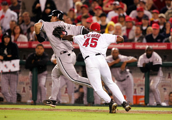 ANAHEIM, CA - OCTOBER 16:  Pitcher Kelvim Escobar #45 of the Los Angeles Angels of Anaheim misses a tag on catcher A.J. Pierzynski #12 of the Chicago White Sox in Game Five of the American League Championship Series on October 16, 2005 at Angel Stadium in